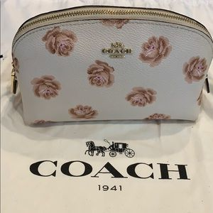 Coach cosmetic case chalk/ rose print
